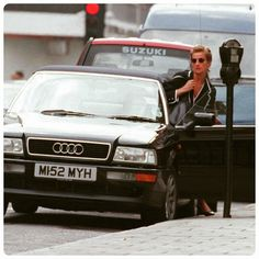 A paparazzi shot of Princess Diana, sporting a 'wet' gelled hairstyle, gets into her black Audi after dinning out with close friend Rosa Monckton at San Lorenzo's restuarant in London on 1995.