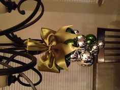 Ornament chandelier I made using ribbon, plastic lanyard and ornaments. Got the idea from Pinterest. Eat your heart out. ;)