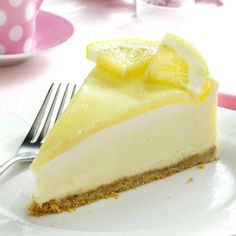Creamy Lemon Cheesecake Recipe -My friend, Gwen, gave me this creamy, lip-smacking recipe, and it's been a crowd-pleaser at my house ever since. The homemade lemon curd on top adds a tart, special touch! The cake can also be made in three store-bought graham cracker pie shells. —Anne Henry, Toronto, Ontario