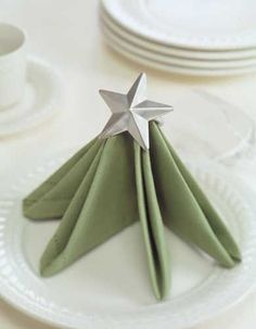 Add seasonal spark to a Christmas table by folding and displaying napkins in creative ways. All Things Christmas, Christmas Time, Christmas Crafts, Christmas Decorations, Christmas Ornaments, Xmas Wedding Ideas, Christmas Tree Napkin Fold, Pantry Labels, Napkin Folding