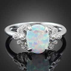 Please give a very warm welcome to the latest addition in our #etsy shop: Oval White Fire Opal Silver Ring http://etsy.me/2o5zCre #jewelry #ring #silver #etsyjewelry #women #opal #opalfashion #opalring #silveropalfashion