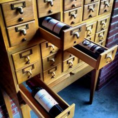A card catalog makes a great #wine rack. #redwine #whitewine #winerack #rack #bottles #storage #cellar #diy #upcycle #recycle #décor #home #interior #design #winelover #catalog #card #library #cwc #cawineclub