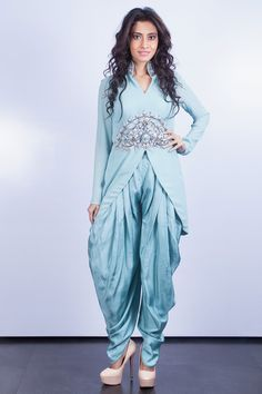 This amazing Indo western outfit in ice blue color is simply inviting and pleasing. Its made from georgette and silk. The crystal and pipebead embellishment which looks pretty dazzling. This stylish high collar embellished top in ice blue looks captivating. With a delicate crystal & pipe bead embellishment on collar, waist and motif on back this piece is radiant and ravishing. Its. easy to wear, has side zip and comes with silk dhoti pants.