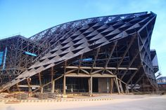 Gallery of In Progress: Dalian International Conference Center / Coop Himmelb(l)au - 1 Dalian, Himmelblau, Sydney Harbour Bridge, Architecture Design, Places To Visit, Louvre, Construction, Exterior, Earth
