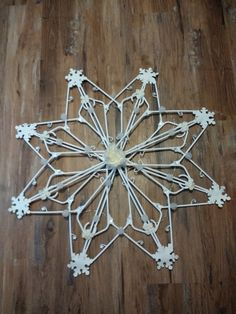 Snowflake made from hangers Snowflake made from hangers Hanger Christmas Tree, Diy Christmas Snowflakes, Candy Christmas Decorations, Snowflake Decorations, Christmas Crafts, Christmas Ornaments, Dollar Tree Crafts, Christmas Projects, Holiday Crafts