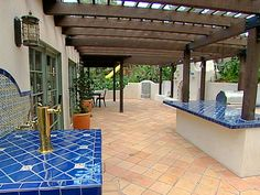 Outdoor kitchen tile ideas on pinterest spanish kitchen for Great outdoor kitchen ideas