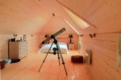 Photo about Wooden bedroom with telescope luxury rural interior. Image of design, lens, rustic - 2718353 Quirky Bedroom, Wooden Bedroom, Attic Conversion, Attic Rooms, Nautical Home, Room Ideas Bedroom, House Goals, Skylight, Telescope