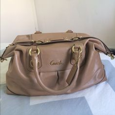 Taupe and Gold Leather Coach Bag In perfect condition. Authentic leather exterior and silk interior. This purse means a lot to me, I will only consider selling it for $300 via PayPal. Feel free to ask questions. No trades on this item. Coach Bags