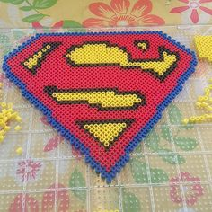 Superman logo perler beads by origamiandpoetry