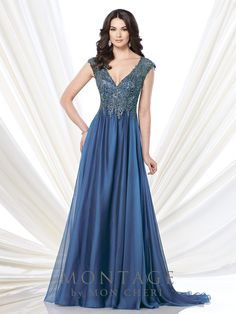 Cap sleeve two-tone chiffon and metallic lace A-line gown with deep V-neckline, metallic lace bodice, keyhole illusion back, gathered chiffon skirt with sweep train. Matching shawl included. Sizes: 4 � 20, 16W � 26W