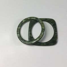 Green plastic circle and square bracelets Green with a metallic sheen. Funky and fun Jewelry
