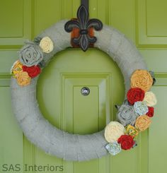 diy tutorial on how to make a burlap wreath with fabric flowers @Hilary McDonald let's make these for fall!