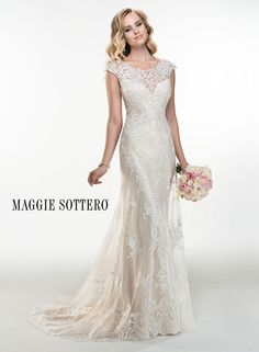 Gorgeous sheath wedding dress, Francesca, by Maggie Sottero, accented with sparkling Swarovski crystals, delicate cap-sleeves and illusion lace back.