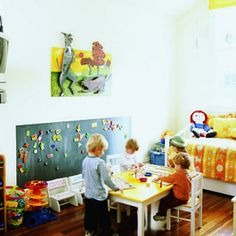 Magnetic paint creates a fun display board in this cheerful playroom.
