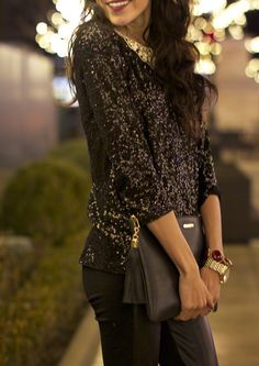 All black and shimmery, accessorized with gold.
