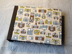 "IONA BINDING - Handmade album that measures 9,84"" x 7,48"". Covered with Japanese fabric."