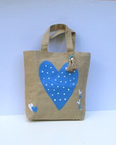 LOVE IS IN THE AIR !    Unique Eco-friendly natural high quality jute bag with applique light blue and white dots heart pattern.    Applique patterns are