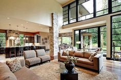 Amazing great room in a contemporary prairie style home via architectural designs