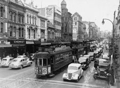 Queen Street, Auckland city, with trams and cars. Signs on buildings advertise Horsley's Chemist; Compton Street, Nz History, Boat Decor, New Zealand Houses, Auckland New Zealand, Cool Pictures, Past, Photographic Prints, Street View