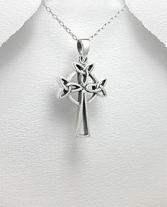 """Hand Crafted Sterling Silver Celtic Cross Pendant. Trinity Knot.  Pendant height including bail is 31mm = 1.22"""".  Pendant width is 19mm = 1.75"""".  Pendant weight is 5.9 grams."""