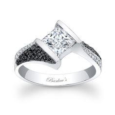 Black and White Diamond Engagement Ring - 7872LBKW - Stunning and unique this black and white diamond engagement ring exudes confidence for the woman who wears it. Featuring a low profile cathedral shank that rises and twists to capture the channel set princess cut diamond center on point. Pave set black and white diamonds artfully adorn the shoulders for a dramatic look of vogue. Also available in 18K and Platinum. LOVE!