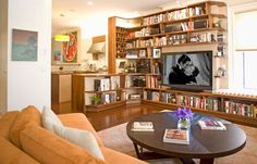 I like the idea of bookcase jutting into room; may help divide our large living room but still provide bookshelves Room, Small Spaces, Diy Dvd Storage, Home, Bookshelves, Storage House, Bookshelves In Living Room, Contemporary Family Rooms, Home And Living