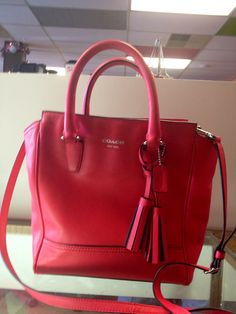 Adorable coral Coach.  At Ms. Mulligan's Consignment Boutique
