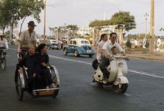 VIETNAM - OCTOBER A man drives his wife and son on a scooter past passengers on a cyclo, Saigon, Vietnam (Photo by Wilbur E. South Vietnam, Hanoi Vietnam, Old Pictures, Old Photos, Michael Morris, Something Just Like This, Home Guard, Indochine, Vietnam History