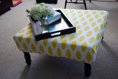 love this idea.. turn an old coffee table into an upholstered ottoman: Tulip and Turnip: DIY: Upholstered Ottoman/Coffee Table