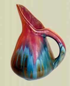 French art pottery Pierrefonds red flambé glazed pitcher with exaggerated spout.  1920′s – 1930′s