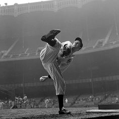 Yankee pitcher Lefty Gomez warms up on the sidelines of Yankee Stadium Sept. 23, 1936. Gomez went 13-7 that season and was elected to the Baseball Hall of Fame in 1972