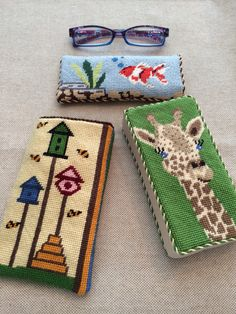 Needlepoint eyeglass cases in all shapes, sizes and designs