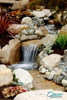 Sandstone was chosen for this stream, connected by a series of small pools, to compliment the Mediterranean style and colors of this luxury home on the shore of Lake Washington. Copyright Oasis Outdoor Environments 2015