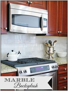 Kitchen Makeover–Adding a new Carrara Marble Backsplash, it's easier then you think and a great way to 'upgrade' your kitchen.