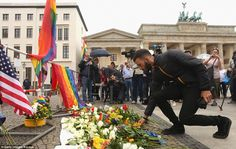 A mourner lays flowers in  Berlin, Germany.The American-born gunman who carried out the atrocity in Orlando had pledged his allegiance to ISIS
