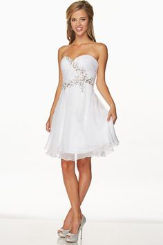 Short Cocktail Dress  Short cocktail dress has sweetheart neckline with ruching and sequin beading, above knee length skirt, lace-up back closure.  https://www.smcfashion.com/wholesale-cocktail-dresses/short-cocktail-dress-jt741w