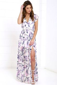 The Where Wildflowers Grow Ivory Floral Print Maxi Dress will be wherever the sunshine goes! Fluttering short sleeves frame a surplice bodice composed of ivory chiffon with a lovely pink and midnight blue floral print. An elasticized waist creates a perfect fit above a maxi skirt with side slit.