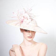 inspiration for the hat that is designed for Huntley to wear to the Queen's Garden Party.