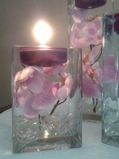 A set of three square vases with purple orchids by WreathsByDiane.  Perfect for your Beach Wedding.