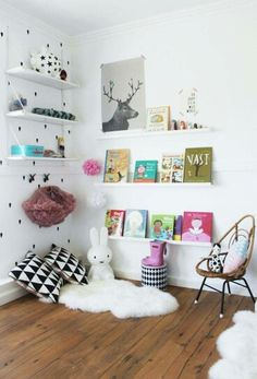 I love floating shelves  in her room! I just need to wait a little longer to do this so she can reach her books.