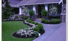 Front Yard Landscaping Ideas For Small Yards - I like the low, round green bushes with the white flowers.