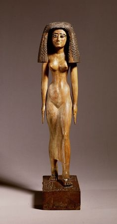 """Wooden grave statue of priestess Imertnebes Middle Kingdom, 12th dynasty, 1991 - 1783 BC  Inscription : """"Gods hand and wife"""", so priestess of the god Amun."""