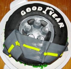 Tire cake with a road on top.