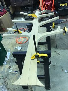 Use the clamps to hold the 2 mdf boards together when cutting
