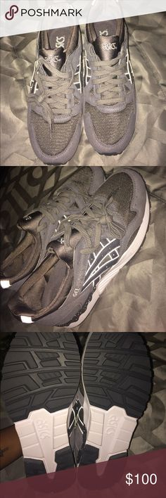 Dark Gray ASICS men's size 8 Brand new ASICS men's 8 . Just wore them 2 min around the house to try them on ! Asics Shoes