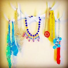 Spray painted antlers turned jewelry storage and room decor