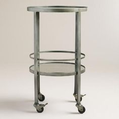 Serve drinks in style with our portable bar cart, featuring a silver finish, mirror shelves and attached wheels. Set up your home bar in the corner or move it round the room to serve guests.