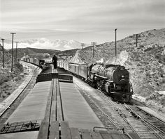 "March 1943. ""Summit, California (vicinity). Passing an eastbound passenger train, the Chief, while coming down the mountain on the Atchison, Topeka & Santa Fe Railroad between Barstow and San Bernardino.""  Medium-format negative by Jack Delano for the Office of War Information."