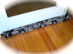 Awesome Zebra print cover. www.createdbycath... #door draft stopper #door sausage #draft excluder #door snake