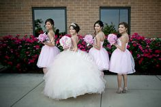 Quinceanera and damas, facing sideways for a photo